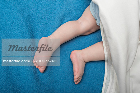Baby on blue blanket Stock Photo - Premium Royalty-Free, Image code: 653-07233741