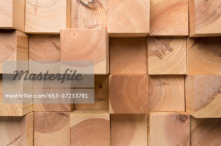 A grid of wooden blocks arranged in varying lengths Stock Photo - Premium Royalty-Free, Image code: 653-07233781