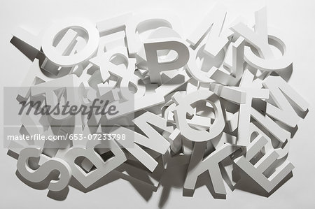 A pile of various white block letters from the alphabet Stock Photo - Premium Royalty-Free, Image code: 653-07233798