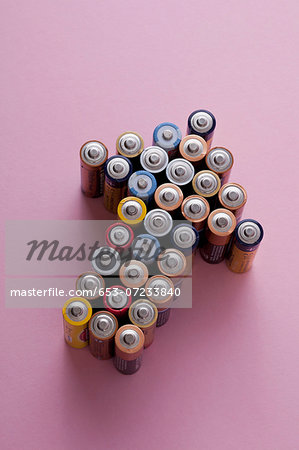 A large group of batteries arranged into the shape of an arrow, pointing up Stock Photo - Premium Royalty-Free, Image code: 653-07233840