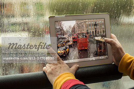 Cropped image of woman photographing bus with digital tablet Stock Photo - Premium Royalty-Free, Image code: 653-07708030