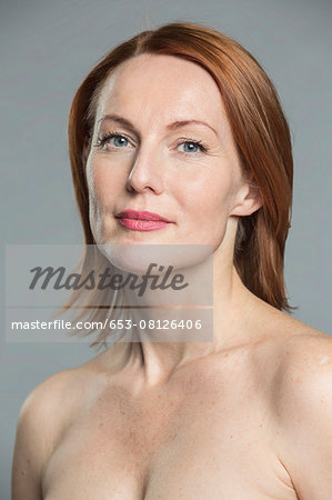 Portrait of topless mature woman against gray background Stock Photo - Premium Royalty-Free, Image code: 653-08126406