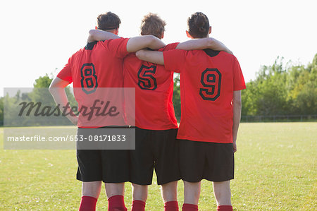 Soccer players celebrating on field Stock Photo - Premium Royalty-Free, Image code: 653-08171833