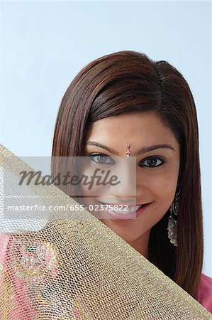 Young woman smiling above veil Stock Photo - Premium Royalty-Free, Image code: 655-02375822