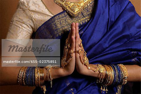Torso of Indian woman wearing sari and jewelry Stock Photo - Premium Royalty-Free, Image code: 655-02375851