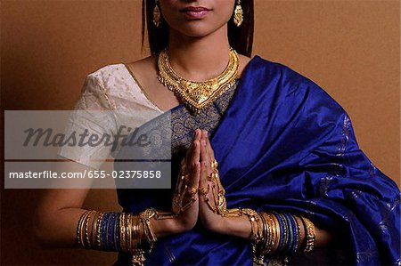 Indian woman with hands held in prayer position Stock Photo - Premium Royalty-Free, Image code: 655-02375858