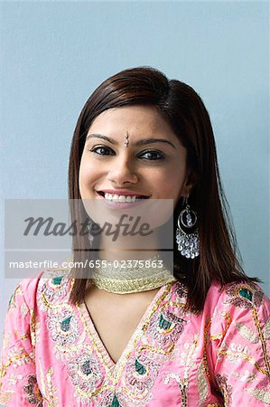Young woman dressed in traditional Indian clothing (salwar kameez) Stock Photo - Premium Royalty-Free, Image code: 655-02375863