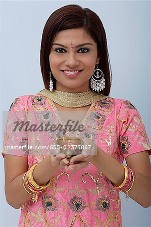 Young woman dressed in traditional Indian clothing (salwar kameez) Stock Photo - Premium Royalty-Free, Image code: 655-02375867