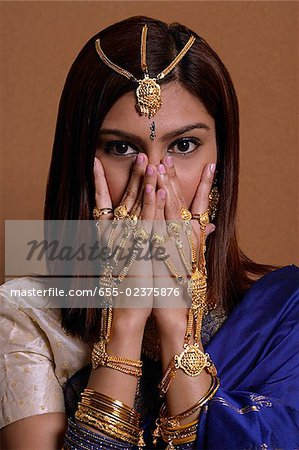 Indian woman wearing traditional wedding jewelry Stock Photo - Premium Royalty-Free, Image code: 655-02375876