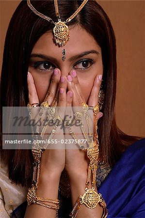 Indian woman wearing traditional wedding jewelry Stock Photo - Premium Royalty-Free, Image code: 655-02375877