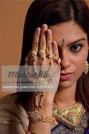 Indian woman wearing traditional wedding jewelry Stock Photo - Premium Royalty-Free, Image code: 655-02375879