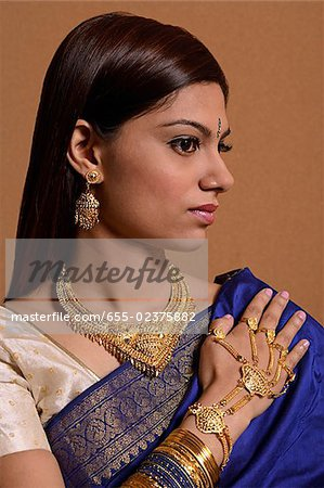 Indian woman wearing traditional wedding jewelry Stock Photo - Premium Royalty-Free, Image code: 655-02375882