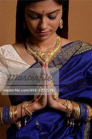 Indian woman wearing traditional wedding jewelry Stock Photo - Premium Royalty-Free, Image code: 655-02375891