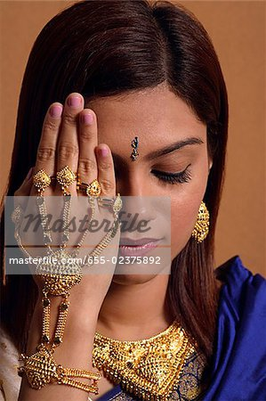 Indian woman wearing traditional wedding jewelry Stock Photo - Premium Royalty-Free, Image code: 655-02375892