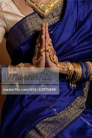Torso of Indian woman wearing sari and jewelry Stock Photo - Premium Royalty-Free, Image code: 655-02375898