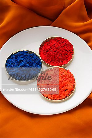 red, blue and orange Indian powder paints Stock Photo - Premium Royalty-Free, Image code: 655-02703065