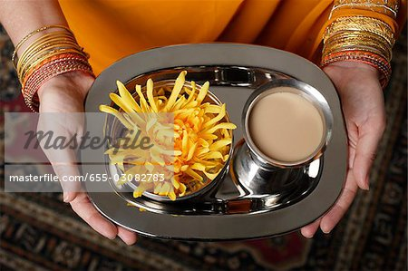 tight shot of woman holding a tray with tea. Stock Photo - Premium Royalty-Free, Image code: 655-03082783
