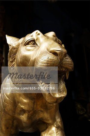 Closeup of bronze tiger head in Little India,Singapore Stock Photo - Premium Royalty-Free, Image code: 655-03082786