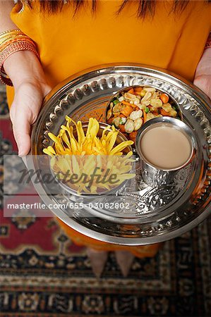 tight shot of a woman holding a tray of tea and snacks Stock Photo - Premium Royalty-Free, Image code: 655-03082802