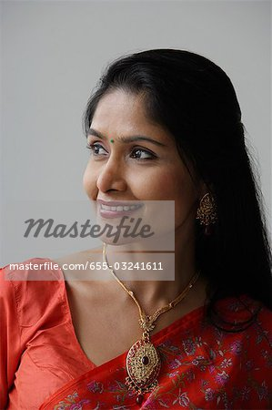 Head shot of Indian woman wearing a sari and smiling Stock Photo - Premium Royalty-Free, Image code: 655-03241611