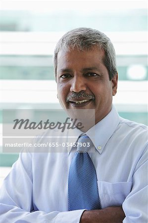 Head shot of Indian business man Stock Photo - Premium Royalty-Free, Image code: 655-03457903