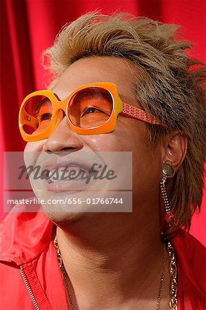Man in hip hop outfit having fun Stock Photo - Premium Royalty-Free, Image code: 656-01766744