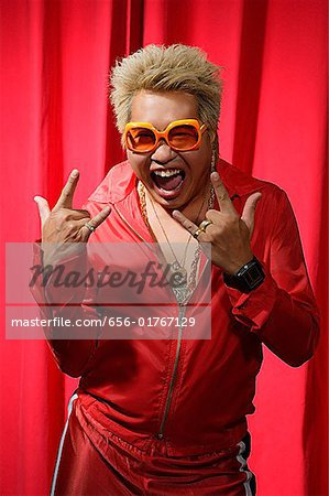 Man in hip hop outfit having fun Stock Photo - Premium Royalty-Free, Image code: 656-01767129