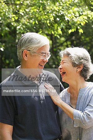 Senior couple facing each other, smiling Stock Photo - Premium Royalty-Free, Image code: 656-01767730