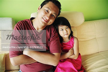 Father with one child, arms crossed Stock Photo - Premium Royalty-Free, Image code: 656-01769511