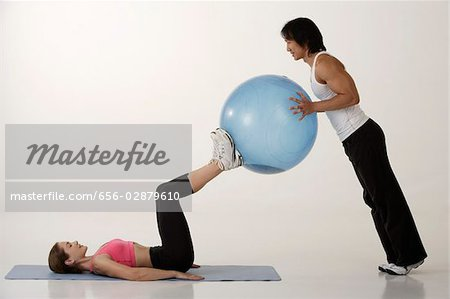 Couple working out with exercise ball Stock Photo - Premium Royalty-Free, Image code: 656-02879610
