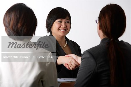 business woman shaking hands Stock Photo - Premium Royalty-Free, Image code: 656-02879664