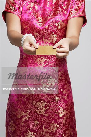cropped shot of woman in pink cheongsam Stock Photo - Premium Royalty-Free, Image code: 656-03076254