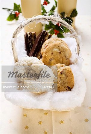 Basket of Christmas baking (coconut crescents, cookies etc.) Stock Photo - Premium Royalty-Free, Image code: 659-01849943