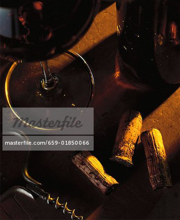 Still life with red wine, wine corks and corkscrew Stock Photo - Premium Royalty-Free, Image code: 659-01850066