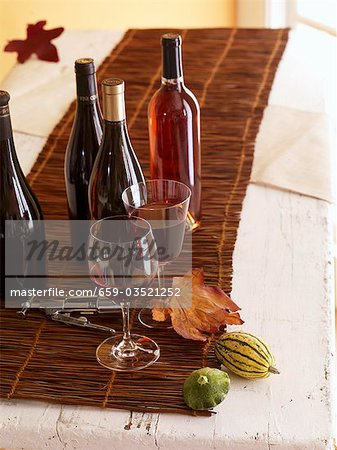 Bottles and Glasses of Wine with Corkscrew Stock Photo - Premium Royalty-Free, Image code: 659-03521252