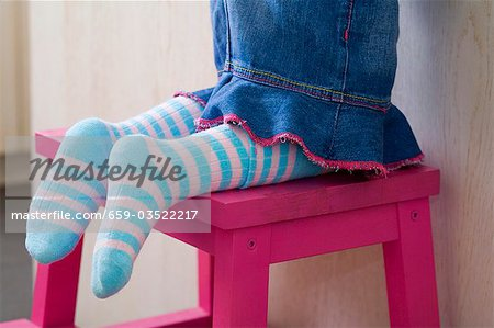Small girl kneeling on a stool (detail) Stock Photo - Premium Royalty-Free, Image code: 659-03522217