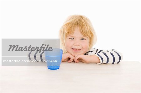 Little girl with beaker of water Stock Photo - Premium Royalty-Free, Image code: 659-03522464