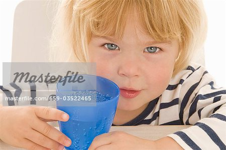 Little girl with beaker of water Stock Photo - Premium Royalty-Free, Image code: 659-03522465