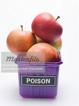 Red apples in a plastic punnet with a 'POISON' label Stock Photo - Premium Royalty-Free, Image code: 659-03529690