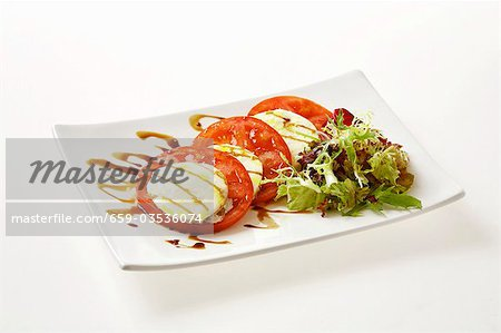 Insalata caprese (Tomatoes and mozzarella, Italy) Stock Photo - Premium Royalty-Free, Image code: 659-03536074