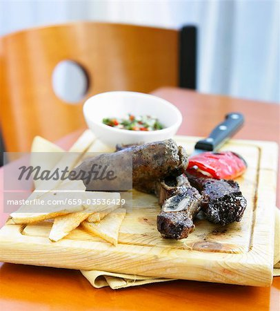 Argentinian Steak with Grilled Red Pepper and Chimichurri Sauce Stock Photo - Premium Royalty-Free, Image code: 659-03536429