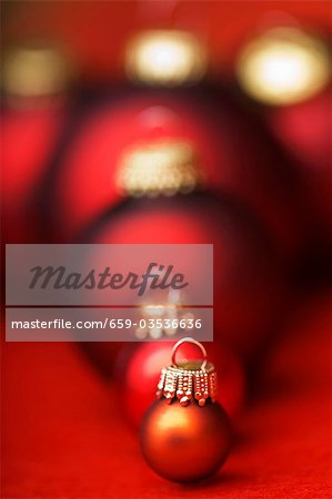 Assorted Christmas baubles in shades of red Stock Photo - Premium Royalty-Free, Image code: 659-03536636
