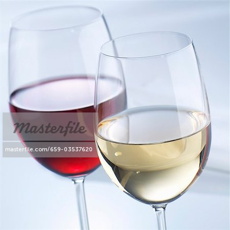 Glass of white wine and glass of red wine Stock Photo - Premium Royalty-Free, Image code: 659-03537620