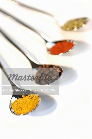 Spoons of curry, allspice, paprika and dried parsley Stock Photo - Premium Royalty-Free, Image code: 659-06151726