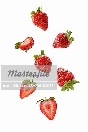 Strawberries, whole and halved Stock Photo - Premium Royalty-Free, Image code: 659-06152033