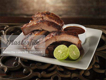 Baby Back Ribs with Lime and Barbecue Sauce Stock Photo - Premium Royalty-Free, Image code: 659-06153159