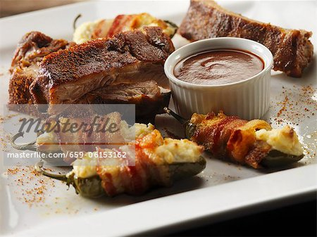 Baby Back Ribs with Bacon Wrapped Cream Cheese Filled Jalapenos Stock Photo - Premium Royalty-Free, Image code: 659-06153162