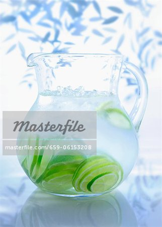 A jug of water with limes Stock Photo - Premium Royalty-Free, Image code: 659-06153208