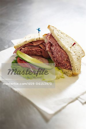 Corned Beef Sandwich on Rye with a Pickle