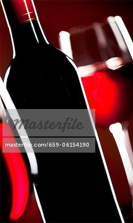 Red Wine Bottle; Glasses of Red Wine Stock Photo - Premium Royalty-Free, Image code: 659-06154190